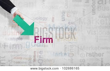 Businessman hand pointing with arrow on word FIRM