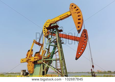 Golden Yellow And Orange Oil Pump Of Crude Oilwell Rig