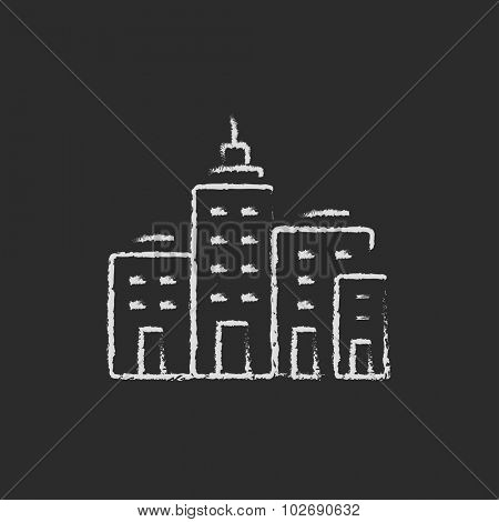 Residential buildings hand drawn in chalk on a blackboard vector white icon isolated on a black background.