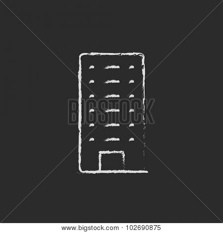 Residential building hand drawn in chalk on a blackboard vector white icon isolated on a black background.