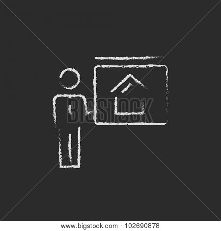 Real estate agent showing the house hand drawn in chalk on a blackboard vector white icon isolated on a black background.