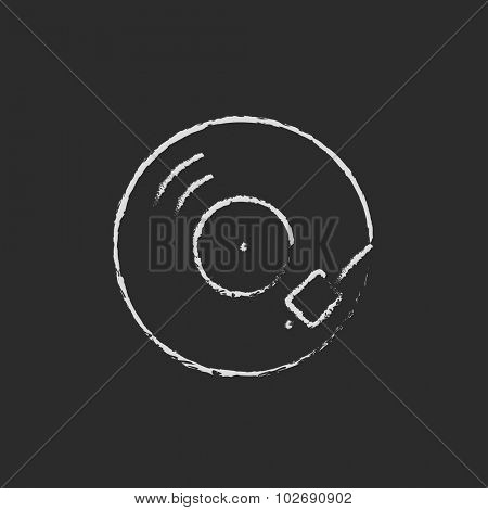 Turntable hand drawn in chalk on a blackboard vector white icon isolated on a black background.
