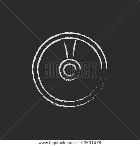 Disc hand drawn in chalk on a blackboard vector white icon isolated on a black background.