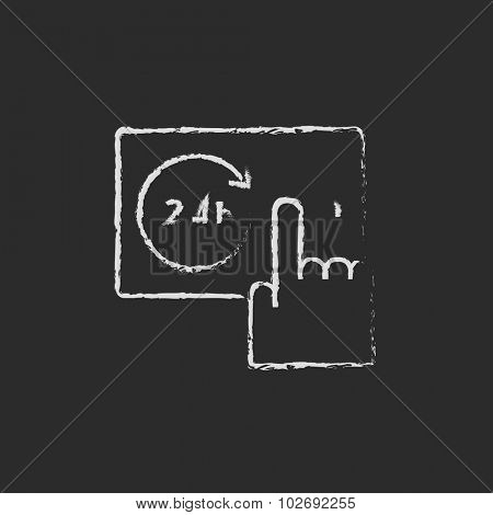Available around the clock hand drawn in chalk on a blackboard vector white icon isolated on a black background.
