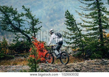 man on bike rides