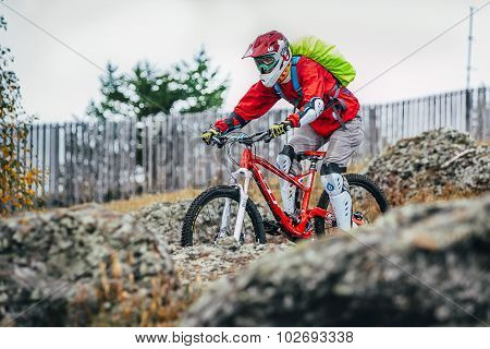 mountainbiker slides down the mountainside