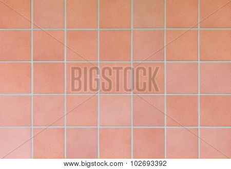 Brown stone tile wall texture and background
