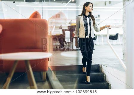 Beautiful Businesswoman Walking Down The Stairs