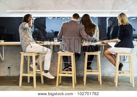 Group Of People Having A Break In The Cafeteria