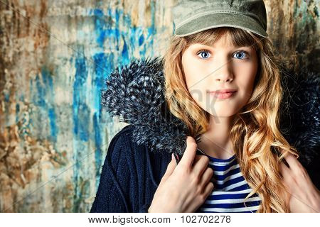 Fashion shot of a modern  teenager girl over grunge background. Beauty, fashion concept.