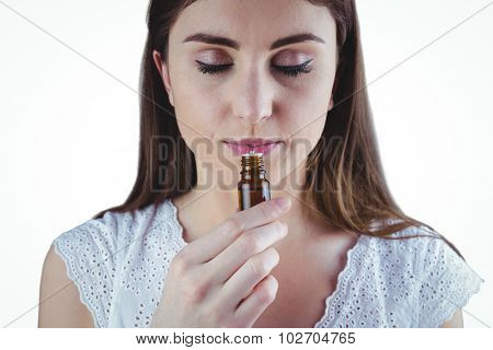 Pretty woman taking alternative tincture on white background
