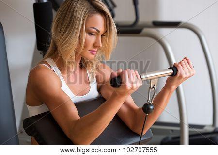 Beautiful girl in sports club on simulator