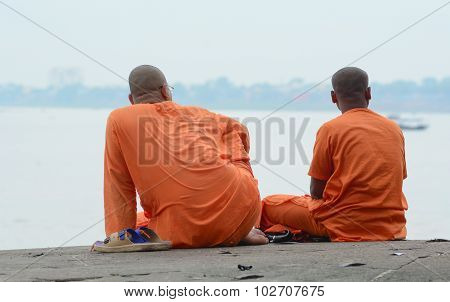 Monks Sit Along The Ganges, Varanasi