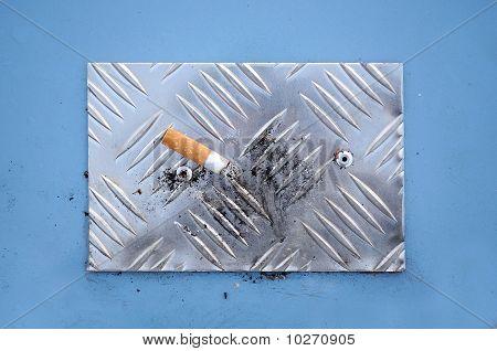 Cigarette End on Cigarette Stubbing Plate