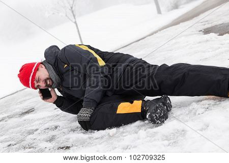 Casualty Man Is Lying On A Icy Way And Calling The Ambulance
