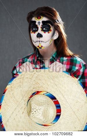 Young woman portrait. Face with make up for Day of the Dead celebration. Unique face art