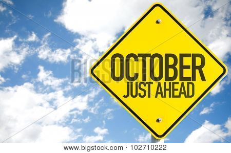 October Just Ahead sign with sky background