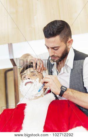 santa claus cut beard from his personal barber