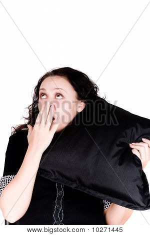 Beautiful Yawning Woman Holding A Pillow