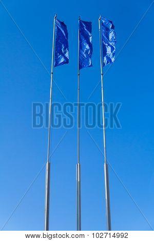 blue flags on sky