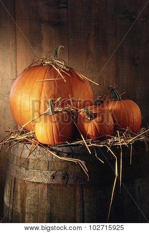 Pumpkins on old barrel in barn