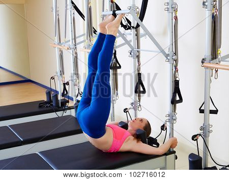 Pilates reformer woman tower exercise workout at gym indoor