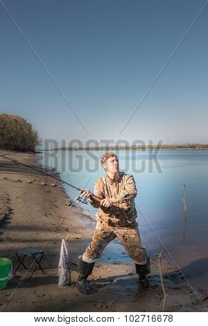 Fisherman At The River