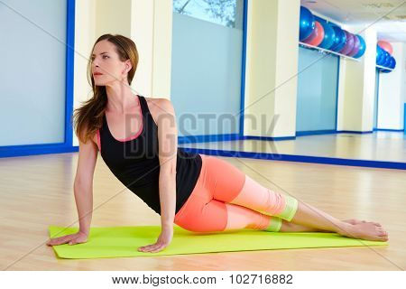 Pilates woman exercise snake workout at gym indoor