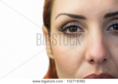 Close-up portrait of woman face against white background