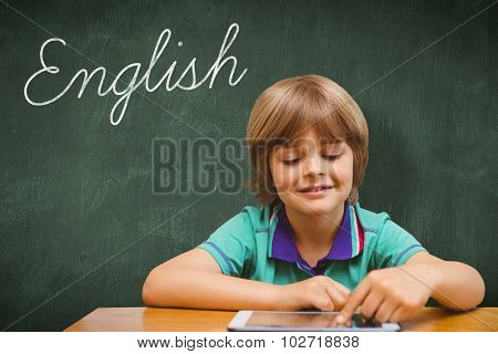 The word english and pupil using tablet pc against green chalkboard