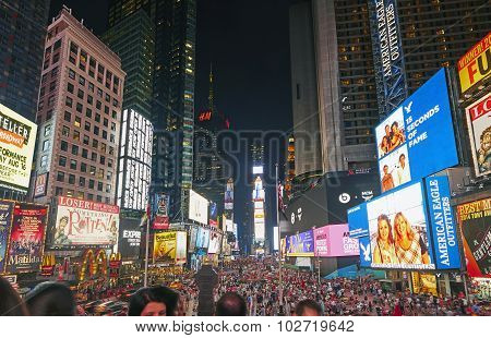 Tourists In Times Square At Night