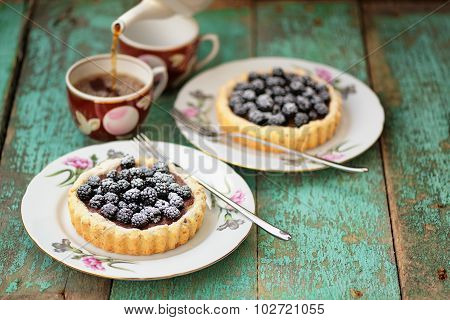 Fancy Homemade Cakes With Fresh Blackberries And Chocolate Cream Decorated With Icing Sugar With Two