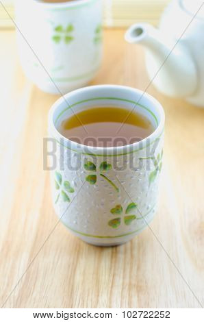 Cup Of Japanese Green Tea On Wooden Table