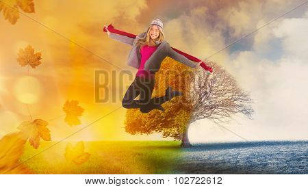 Pretty blonde posing in winter clothes against autumn turning to winter