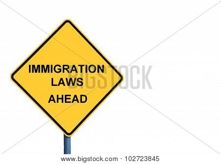 Yellow Roadsign With Immigration Laws Ahead Message