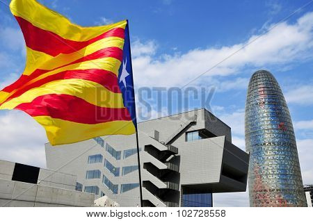 BARCELONA, SPAIN - SEPTEMBER 11: A pro-independence flag with the Agbar Tower in the background on September 11, 2015 in Barcelona, Spain, during the rally in support for the independence of Catalonia