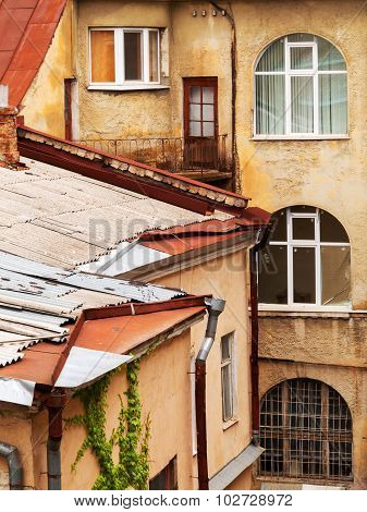 The Windows And Roofs Of The Old Houses In The City Court.