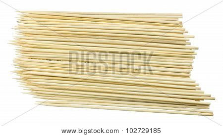 Pile Of Wooden Skewers On A White Background