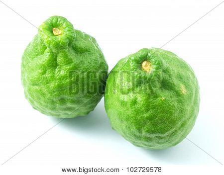Two Kaffir Lime Fruits On A White Background