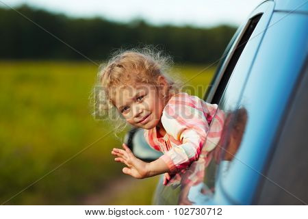 Little Girl Waving From Car Window