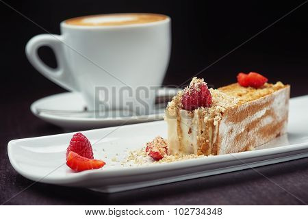 beautiful cake dessert with coffee cream and fresh berry