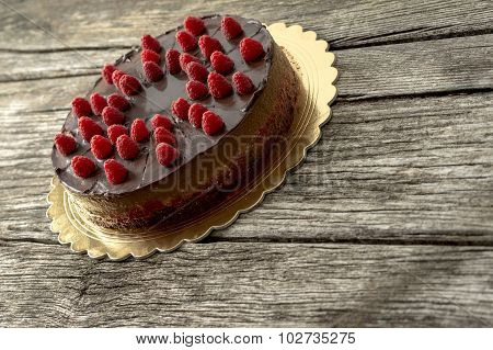 Delicious Home Made Chocolate Cake Decorated With Fresh Raspberries