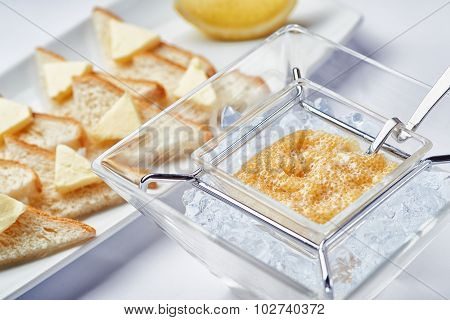 Breakfast fresh caviar on ice with toasts