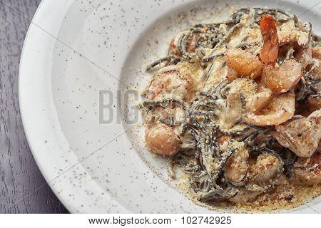 Italian black spaghetti with shrimp and octopus