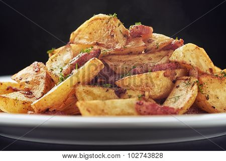 Roasted potatoes with bacon and mushrooms