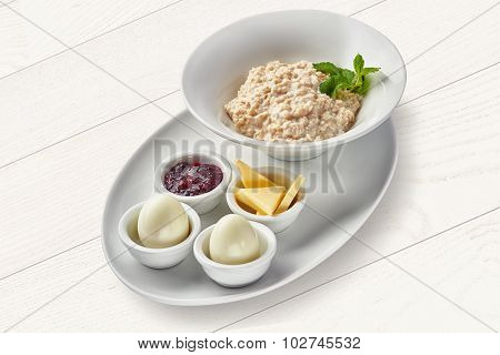 English breakfast with porridge and hard-boiled eggs