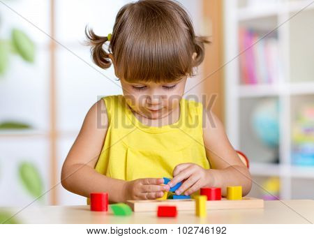 child plays with colorful education toy