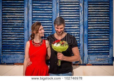valentines day couple holding flowers