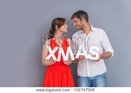 couple holding cristmas letters