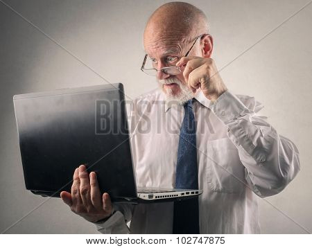 Businessman looking at the screen of his laptop